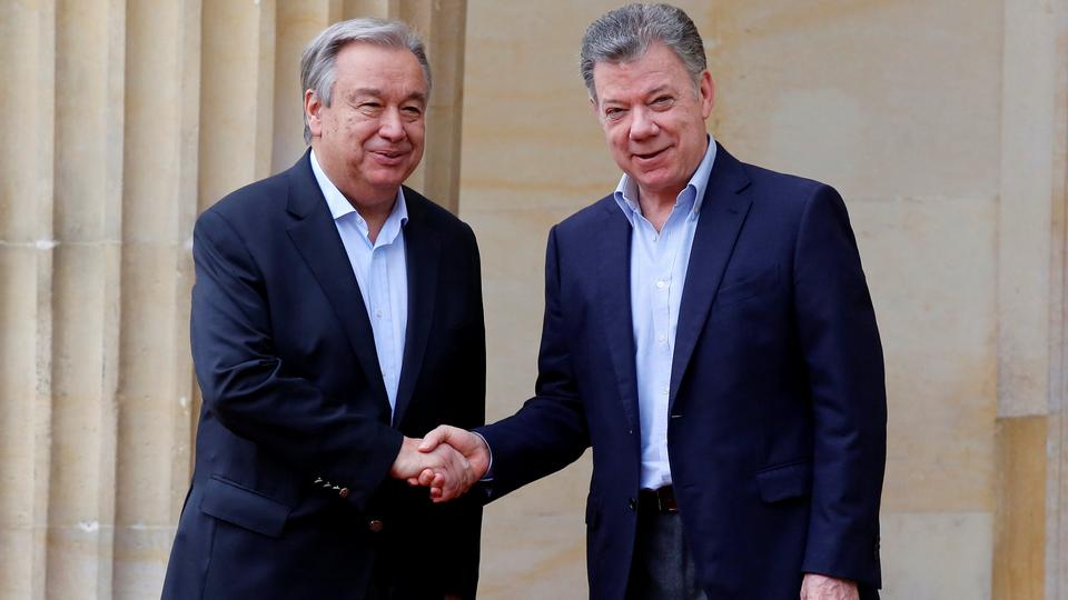 Colombia's President Juan Manuel Santos and UN Secretary General Antonio Guterres shake hands outside the presidential palace in Bogota, Colombia on January 13, 2018.