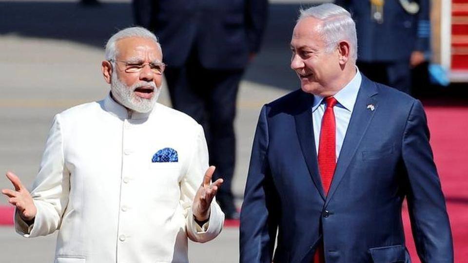 Israeli Prime Minister Benjamin Netanyahu welcomes Prime Minister Narendra Modi during an official welcoming ceremony upon his arrival in Israel at Ben Gurion Airport, near Tel Aviv on Israel July 4, 2017.