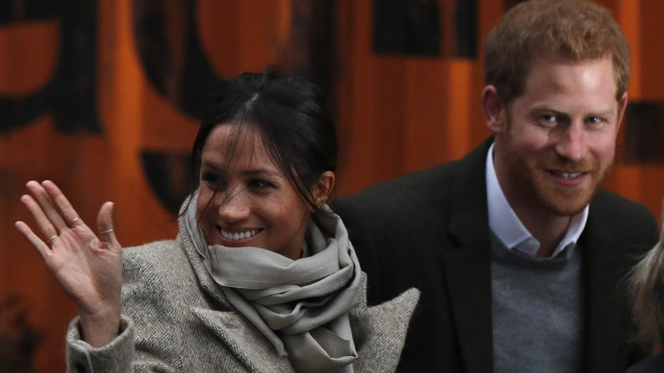 This file photo taken on January 09, 2018 shows Britain's Prince Harry and his fiancée US actress Meghan Markle arriving for their visit to Reprezent 107.3FM community radio station in Brixton, south west London on January 9, 2018.