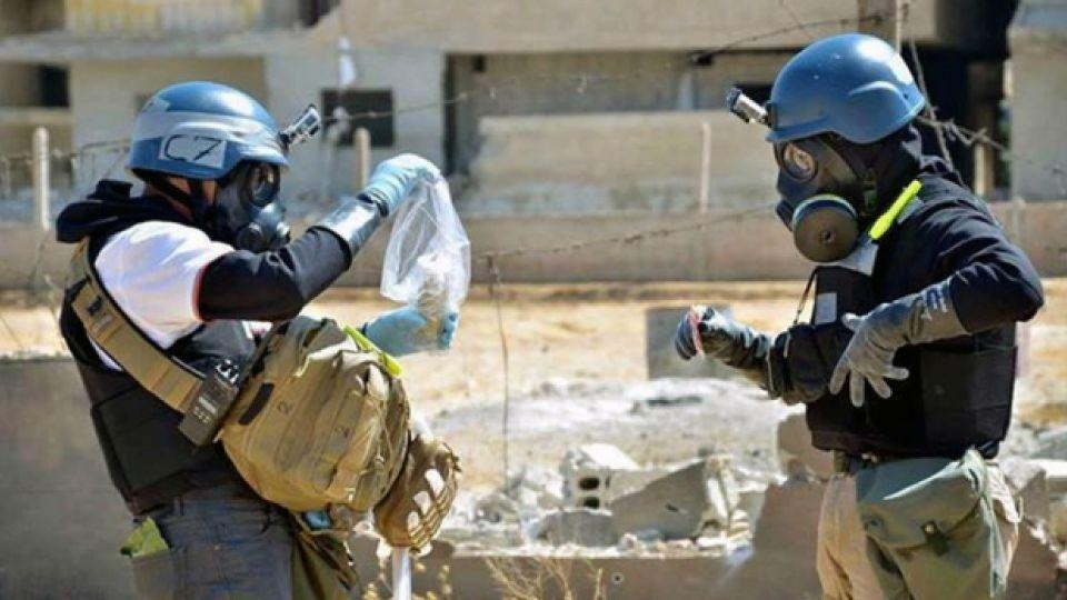 OPCW inspectors examine and collect evidence from a chemical attack site in Syria.