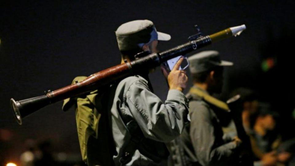 Afghan policemen stand guard at the site of an attack at American University of Afghanistan in Kabul, Afghanistan