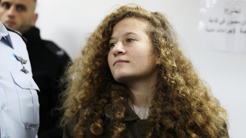 Palestinian teen Ahed Tamimi enters a military courtroom at Ofer Prison, near the West Bank city of Ramallah on January 15, 2018.