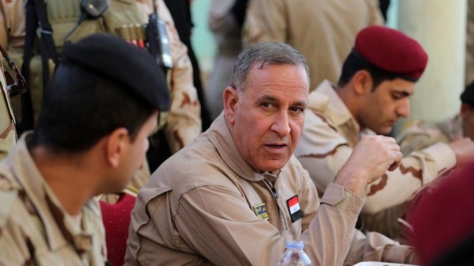 In a file photo, the impeached Iraqi Defense Minister Khaled al-Obeidi, centre, speaks to his soldiers at a military base in Tikrit, 130 kilometres north of Baghdad, Iraq.