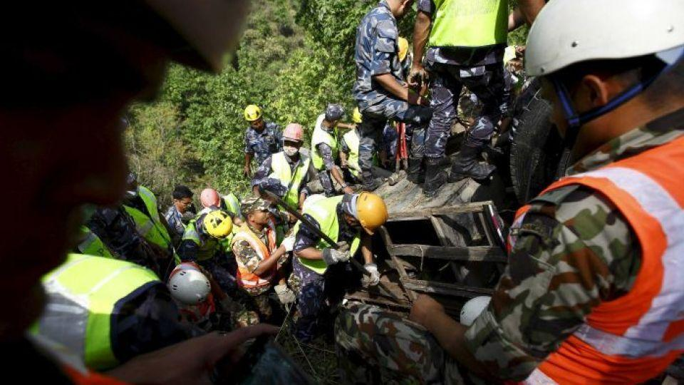 In this file photo, rescue teams work to recover the bodies of victims from the wreckage of a bus at Jayaprekhola in Dhading district, on the outskirts of Kathmandu, Nepal. Accidents are relatively common on Nepal's highways because of poor roads.