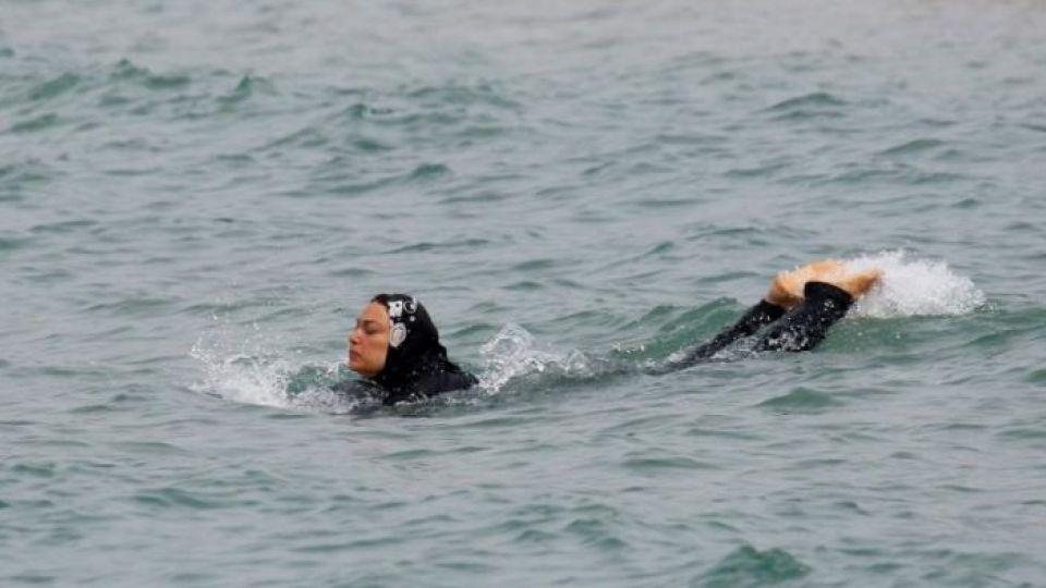 A Muslim woman wears a burkini – a swimsuit that leaves only the face, hands and feet exposed – as she swims in the Mediterranean Sea in Marseille, France, August 17, 2016
