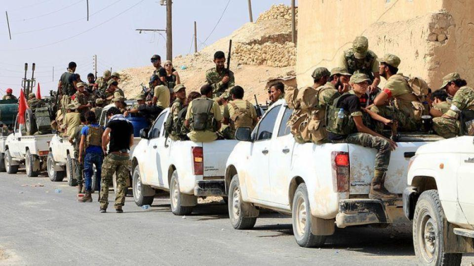 A file photo shows a Free Syrian Army convoy.