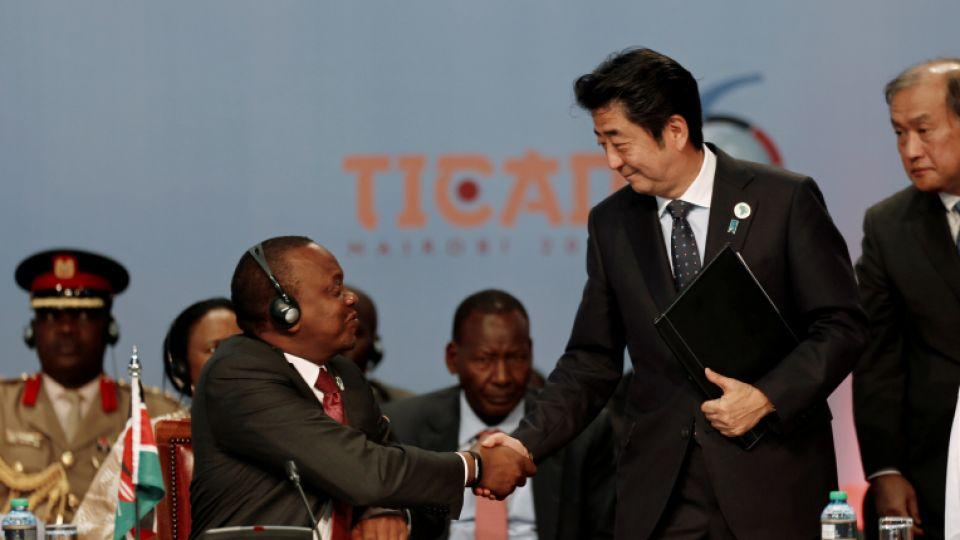 Japan's Prime Minister Shinzo Abe (R) greets Kenya's President Uhuru Kenyatta as they attend Sixth Tokyo International Conference on African Development (TICAD VI) in Kenya's capital Nairobi, August 27, 2016.