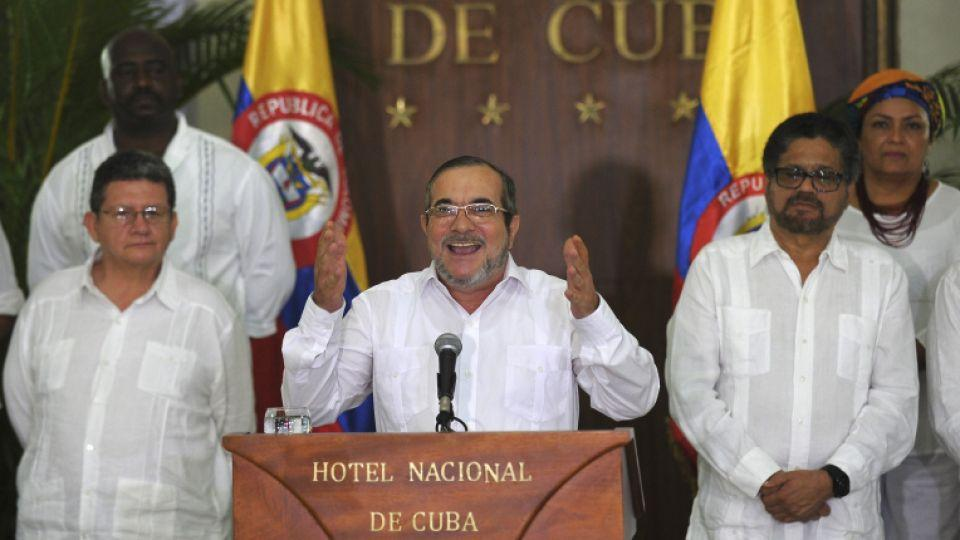 "The head of Colombia's FARC leftist guerrilla, Timoleon Jimenez, aka ""Timochenko"" (C), speaks during a press conference with other members of his delegation in Havana on August 28, 2016."