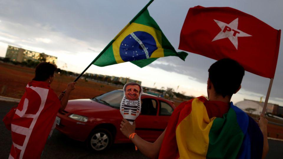 A person waves a Brazilian flag at a camp in support of Brazil's suspended President Dilma Rousseff, in Brasilia, Brazil, August 28, 2016.