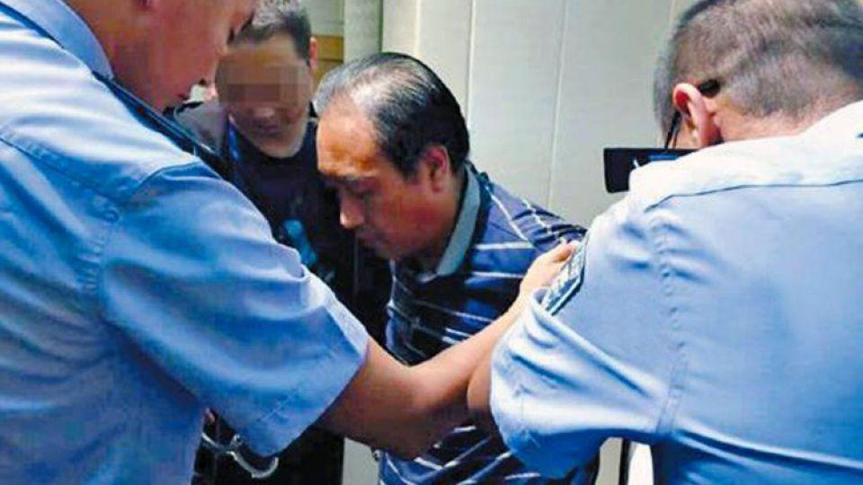 A YouTube screengrab from Chinese media shows the arrest of China's 'Jack the Ripper'.