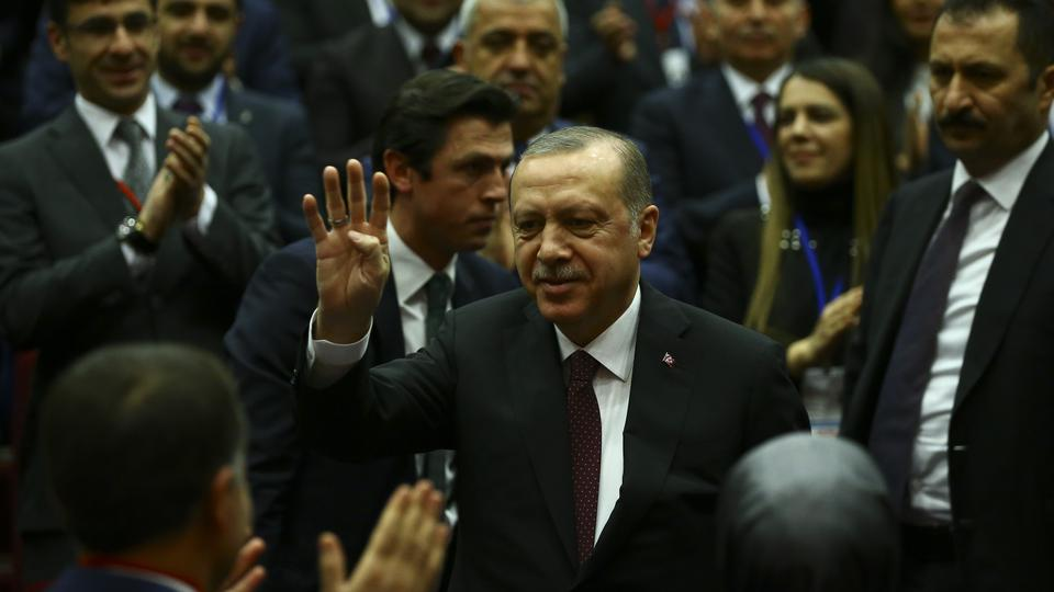 Turkish President Recep Tayyip Erdogan (C) greets the crowd as he arrives to attend Turkey's governing Justice and Development (AK) Party's extended meeting of provincial heads at the AK Party's headquarters in Ankara, Turkey on January 26, 2018.