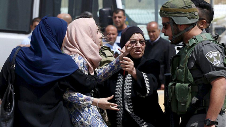 Palestinian women argue with an Israeli border policeman at Qalandia checkpoint near the West Bank city of Ramallah.