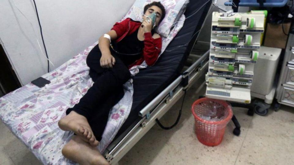 A civilian breathes through an oxygen mask at al-Quds hospital, after chlorine bombs were dropped on Aleppo, Syria, early August 11, 2016.