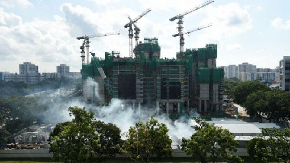Fumigation work is underway at a construction site near the Aljunied housing estate in Singapore on August 31, 2016.