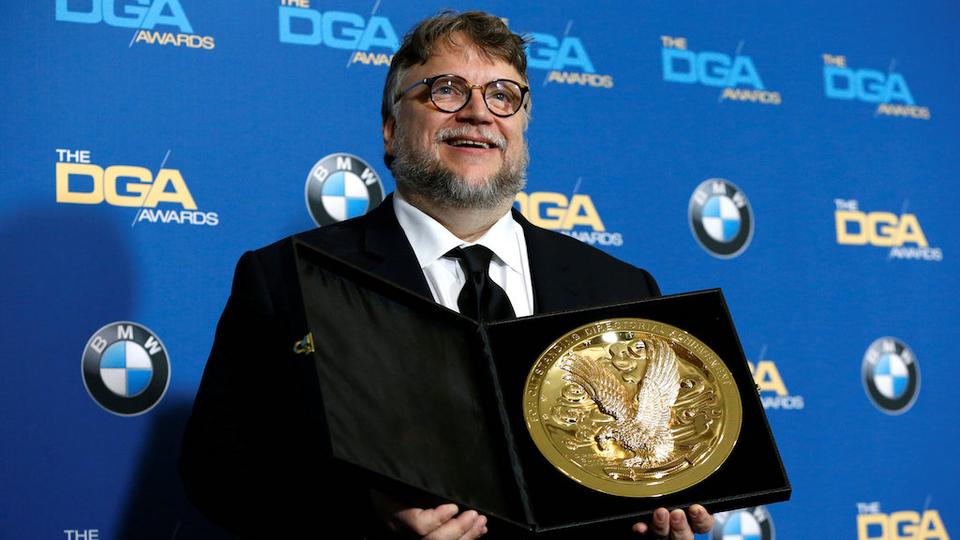 Director Guillermo del Toro holds his award for Outstanding Directorial Achievement in Feature Film for