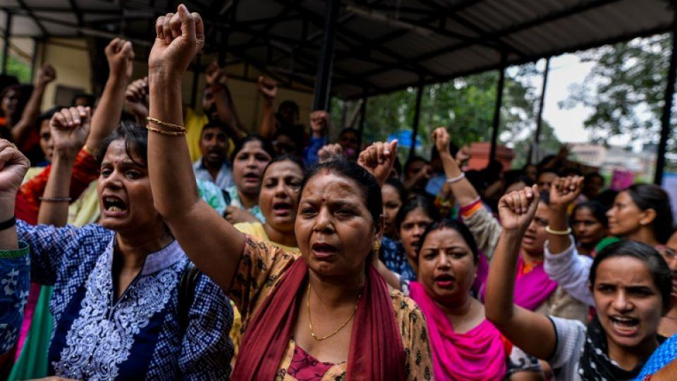 Nurses at an Indian government hospital shout slogans during a protest in New Delhi on September 2, 2016, during a nationwide strike staged by various trade unions.