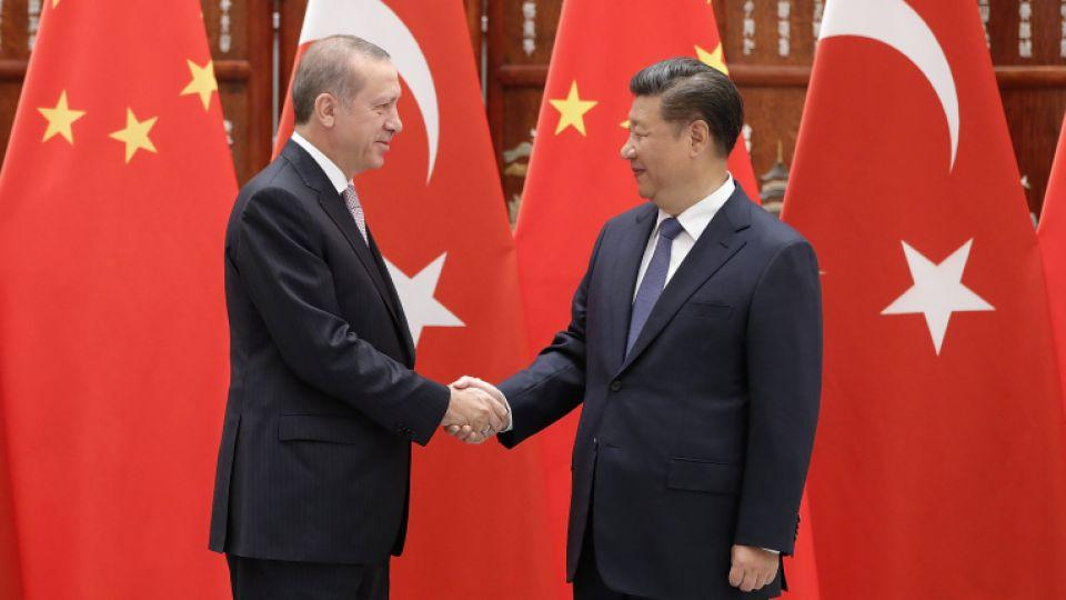 Chinese President Xi Jinping shakes hands with Turkish President Recep Tayyip Erdogan before their meeting at the West Lake State Guest House