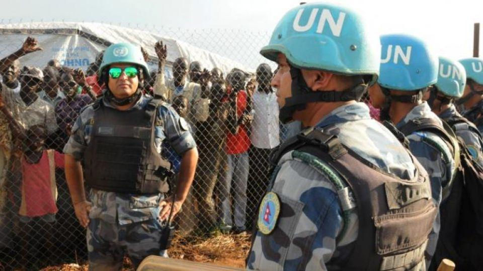 U.N. peacekeepers stand guard at a demonstration by people displaced in the recent fighting, during a visit by the United Nations Security Council, delegation to the UN House in Jebel, near South Sudan's capital Juba, September 3, 2016.
