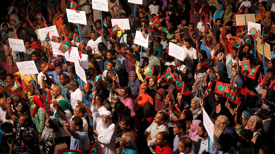 Hundreds of opposition supporters chanted slogans such as