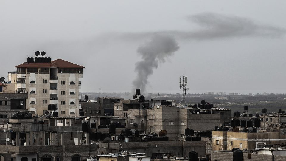 A picture taken on February 10, 2018 from Rafah in the southern Gaza Strip shows smoke billowing on the Egyptian side of the border following an explosion. Egypt closed its border with the Gaza Strip, Palestinian officials said, after Cairo launched a major operation against militants in the Sinai Peninsula.