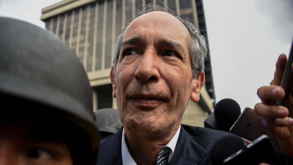 Former Guatemalan President Alvaro Colom is arrested under corruption charges in Guatemala City on February 13, 2018.