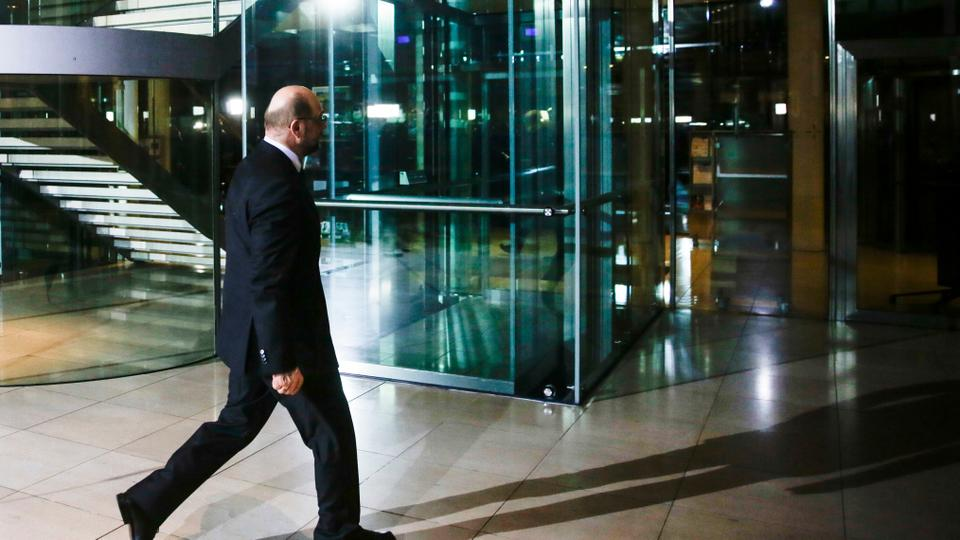 Martin Schulz leaves after he announced his resignation as Social Democratic Party, SPD, chairman at the party's headquarters in Berlin, Tuesday, Feb. 13, 2018.