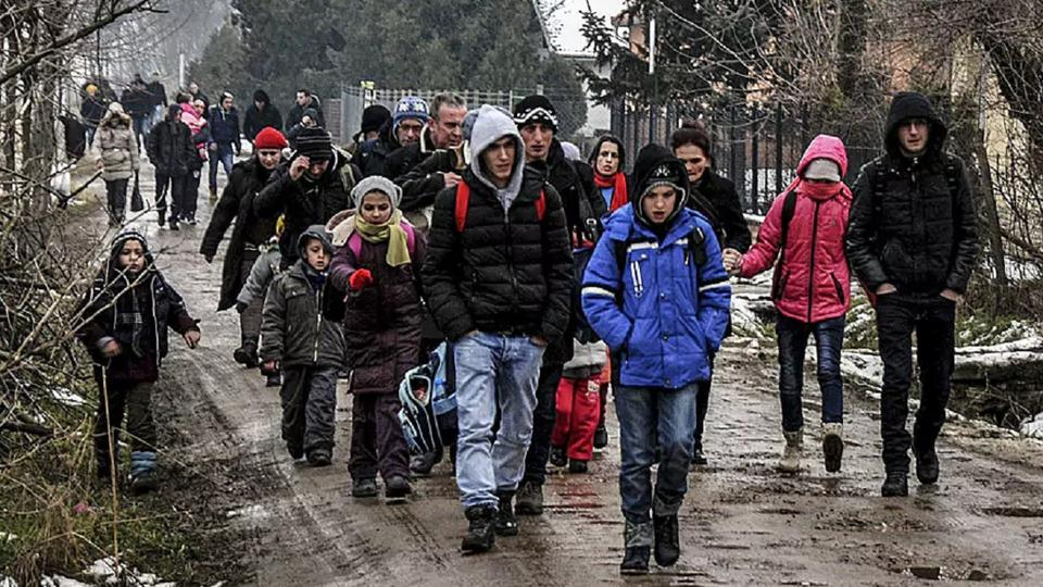Kosovars from the city of Pristina walk on a street in Belgrade. Once in Serbia, the Kosovans first take buses to Subotica, the nearest city to the Hungarian border, then take taxis to the border and walk into Hungary.