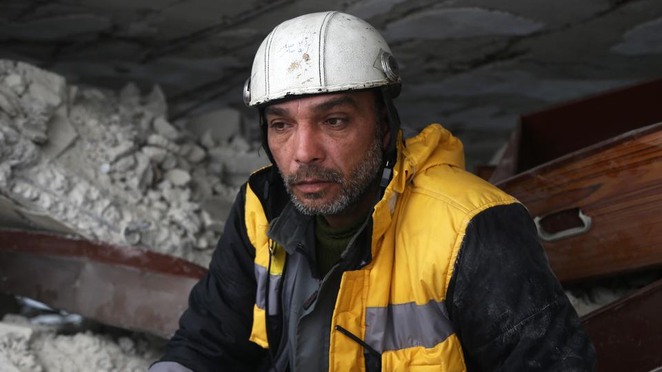 Forty-five-year-old Samir Salim, who along with his three brothers are members of the White Helmets rescue forces, sits in the rubble of his destroyed home in the town of Medeira in Syria's rebel-held Eastern Ghouta region. February 12, 2018.