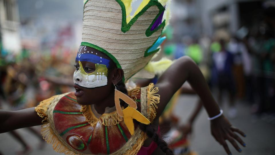 A dancer performs as she parades along a street at the National Carnival in Port-au-Prince, Haiti, on February 11, 2018.
