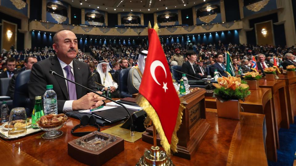 Turkish Foreign Minister Mevlut Cavusoglu (L) participates in the 'International donor conference for Iraqi reconstruction ' on February 14, 2018 in Kuwait City, Kuwait.