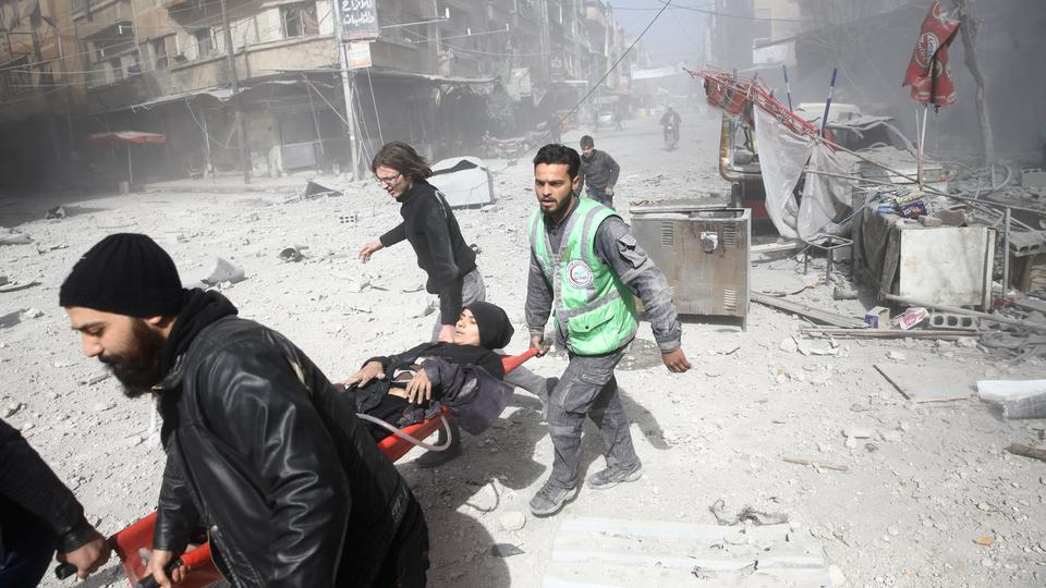 An injured woman is carried on a stretcher after an airstrike in the besieged town of Douma in eastern Ghouta in Damascus, Syria on February 7, 2018.