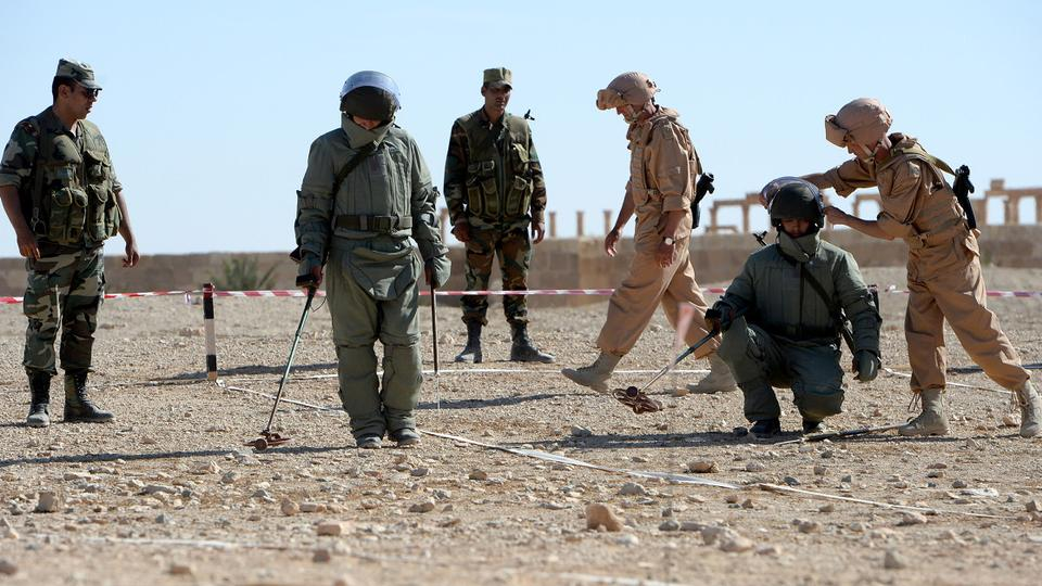 Russian army officers train Syrian regime soldiers at their military camp known as the International Demining Center in the ancient Syrian city of Palmyra on May 5, 2016.