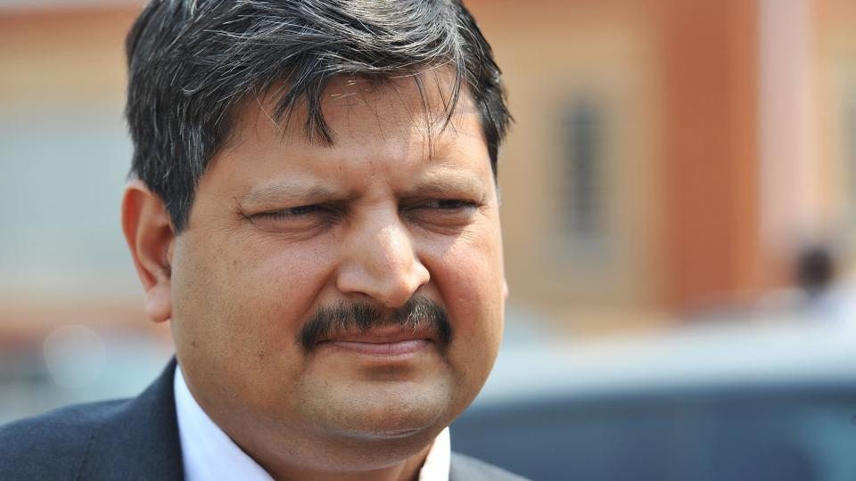 In this photo taken in September 2010 Atul Gupta is seen outside magistrates courts in Johannesburg.