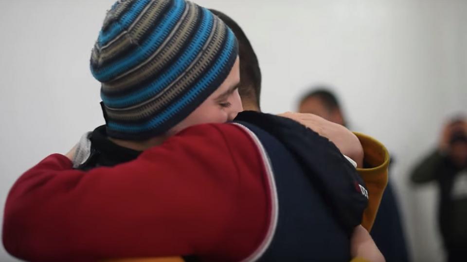 Khalil Abdulghabour huging his friend, also a former DAESH member