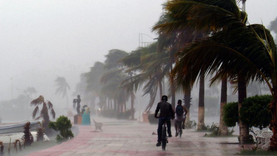 Two men ride bikes along the seaside Boulevard of Los Cabos during the passage of Hurricane Newton, in Baja California Sur state, Mexico, on September 6, 2016.