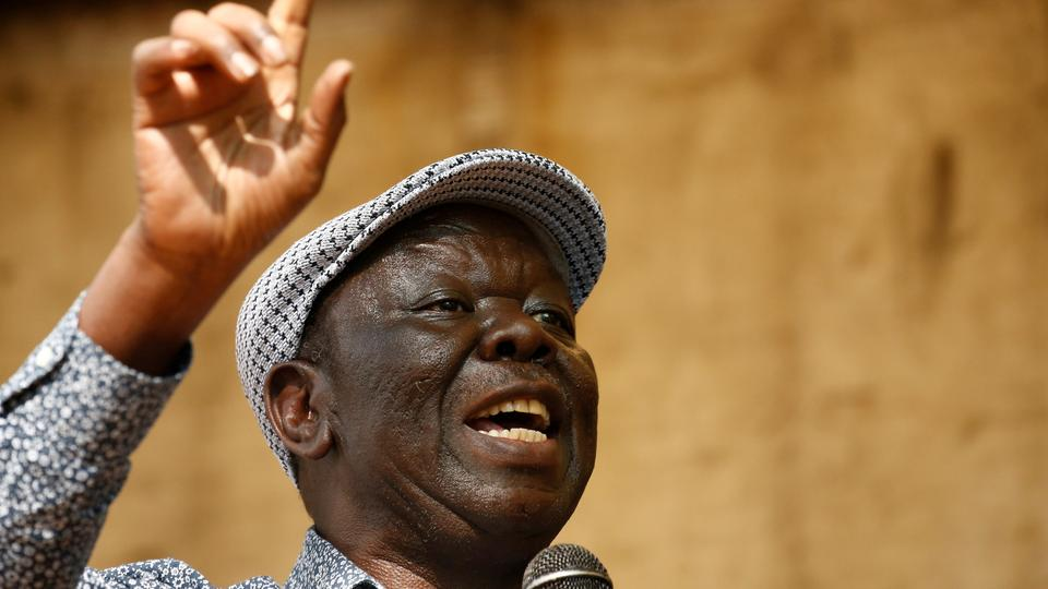 Opposition Movement for Democratic Change leader Morgan Tsvangirai addresses a crowd gathered outside parliament in Harare, Zimbabwe, November 21, 2017.