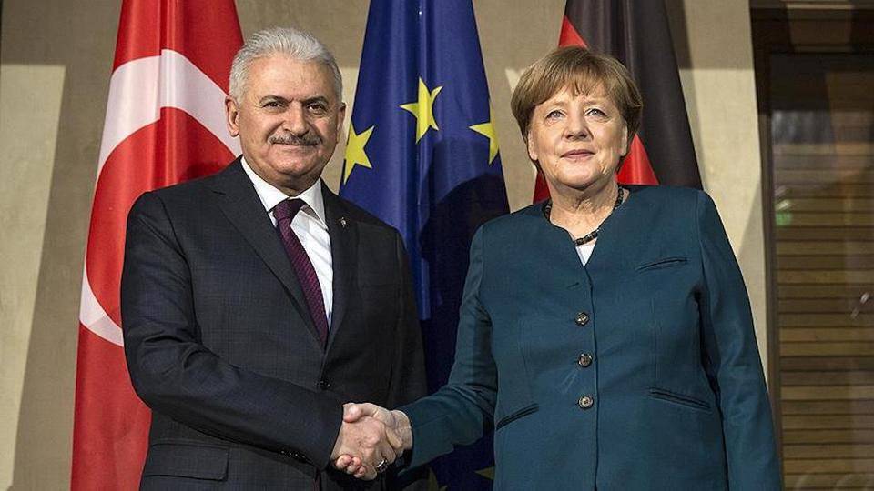 Following the meeting with German Chancellor Angela Merkel (R) Turkish Prime Minister Binali Yildirim (L) to attend to Munich Security Conference.