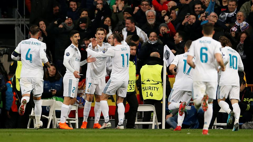 Real Madrid's Cristiano Ronaldo celebrates scoring their second goal with teammates in a match against Paris St Germain, in Madrid, Spain, on February 14, 2018.