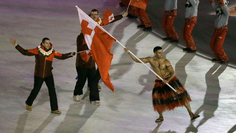 Pita Taufatofua carries the flag of Tonga during the opening ceremony of the 2018 Winter Olympics in Pyeongchang.