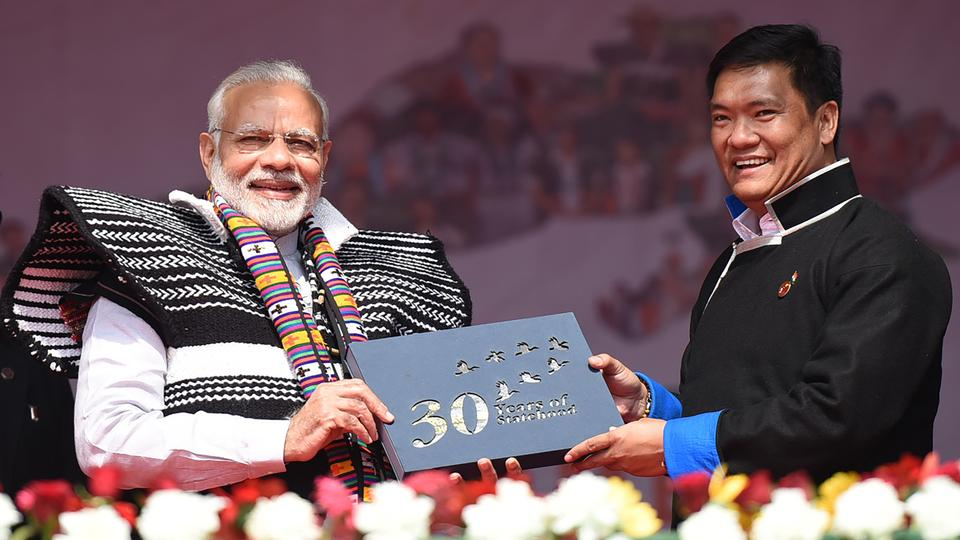 Chief Minister of Arunachal Pradesh, Shri Pema Khandu presenting a gift to Indian Prime Minister Narendra Modi to mark the 30 years of statehood at the inauguration of the Dorjee Khandu State Convention Centre in Itanagar. February 15, 2018.