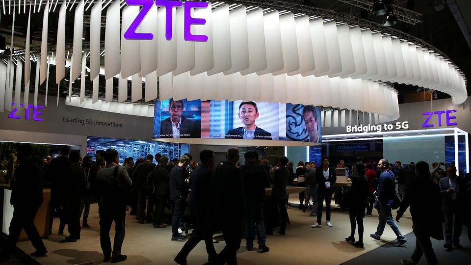 People stand at ZTE's booth during Mobile World Congress in Barcelona, Spain on February 27, 2017.