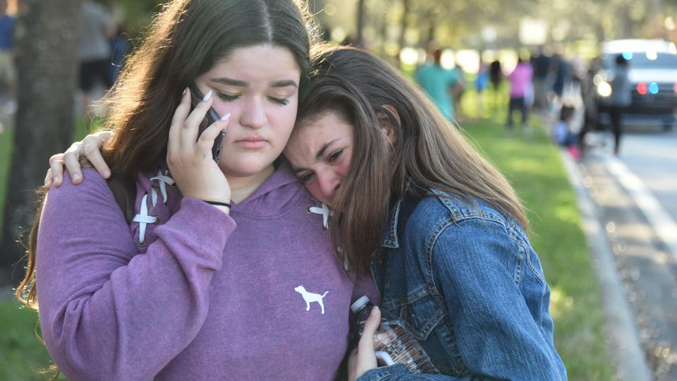 Students in tears following a shooting at Marjory Stoneman Douglas High School in Parkland, Florida, a city about 80 kilometers north of Miami on February 14, 2018.