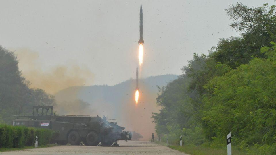 This undated picture released from North Korea's official Korean Central News Agency (KCNA) on September 6, 2016 shows the fire drill of ballistic rockets by Hwasong artillery units of the KPA Strategic Force at an undisclosed location in North Korea.