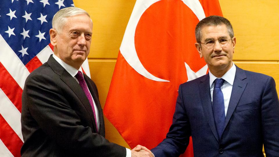 US Secretary of Defense James Mattis poses with Turkish Defence Minister Nurettin Canikli during a NATO defence ministers meeting at the Alliance headquarters in Brussels, Belgium, February 14, 2018.