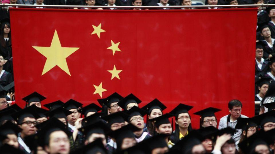 Students attend their college graduation ceremony in Shanghai's Fudan University July 2, 2011.