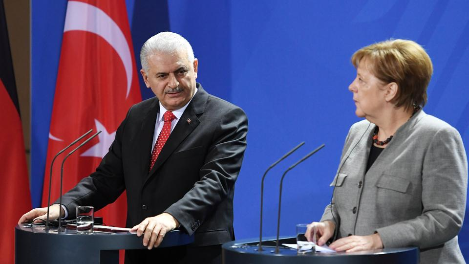 German Chancellor Angela Merkel and Turkish Prime Minister Binali Yildirim attend a news conference at the Chancellery in Berlin, Germany February 15, 2018.