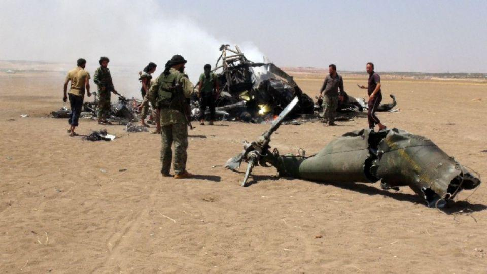 Members of Syrian opposition groups gather around the wreckage of the Russian Mi-8 military helicopter which was shot down in August.