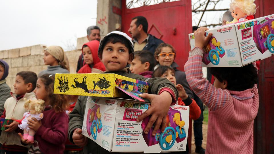 Syrian children hold toys after The Turkish Red Crescent distributed humanitarian aid and toys to families and children in the village of Deir Ballut of Jandaris, Afrin, Syria, which was cleared of YPG/PKK terrorists by Turkey's ongoing