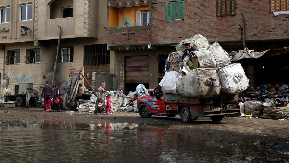 Women in Egypt slum repurpose waste into colourful items