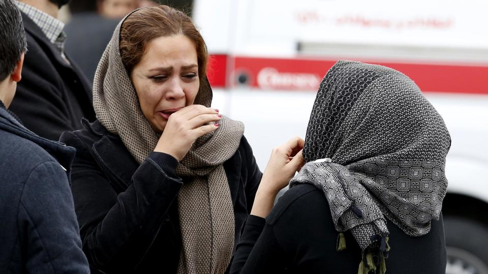 Relatives of Iranian passengers, onboard the Aseman Airlines flight EP3704, react as they gather in front of a mosque near Tehran's Mehrabad airport on February 18, 2018.
